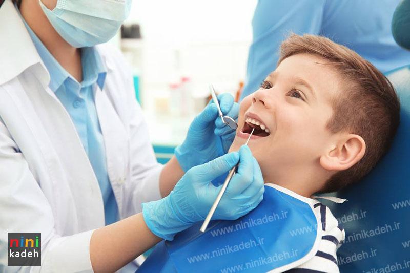 کشیدن دندان شیری کودک
